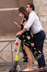 Lily James Hops on an electric scooter to go sightseeing in Rome