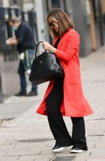 Myleene Klass Stands out in bright red coat at Smooth radio in London