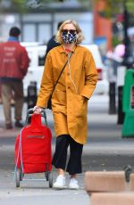 Naomi Watts Looks stylish in a yellow coat while out shopping in Tribeca