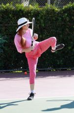 Phoebe Price Finds new places to store her tennis balls while playing on the courts in Los Angeles