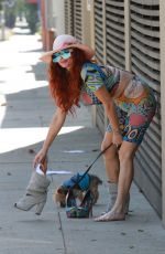 Phoebe Price Seen walking her dog Henry and changing shoes