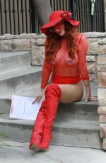 Phoebe Price Shows off her curves in a red outfit as she shows her voting stickers from voting early in Los Angeles