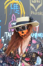 Phoebe Price Shows off her Halloween face mask in Hollywood