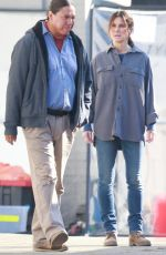Sandra Bullock Shoots a scene carrying lumber while working on the untitled Netflix film in Vancouver