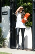 Shay Mitchell Waves a Canadian flag around downtown Los Angeles while filming a project with husband Matte Babel
