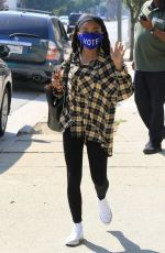 "Skai Jackson Seen on her phone wearing a blue ""Vote"" mask as she heads into the DWTS studio in Los Angeles"