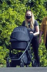 Sophie Turner In Black tights out with her baby in LA