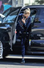 Stella Maxwell Walk arm-in-arm with a mysterious guy during a visit to CVS