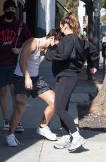 Addison Rae Is lifted in the air over the shoulders of boyfriend Bryce Hall after a workout in West Hollywood