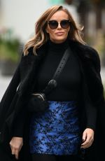 Amanda Holden Looks stylish wearing a blue mini skirt and her long black coat at the Heart Radio Studios in London