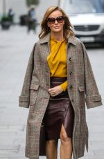 Amanda Holden Pictured at Heart radio in burgundy leather dress and mustard yellow top in London