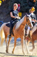 Amber Heard Hugs it out with her girlfriend before heading out on a horseback ride