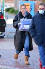Anna Paquin Tends to an infant in a stroller on the set of