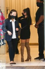 Ariana Grande In Short black dress and boots out in Beverly Hills