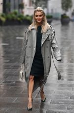 Ashley Roberts Rocks office chic in silver coat and pencil skirt in London