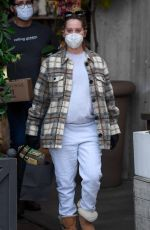 Ashley Tisdale Shows off Her growing baby bump on a trip to rolling greens farm and garden store in Los Angeles
