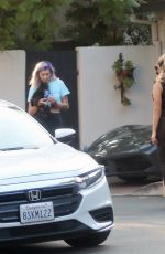 Bebe Rexha Gets a New Ferrari Delivered to Her Home in LA