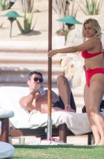 Bebe Rexha In a red bikini while out enjoying a romantic vacation in Cabo San Lucas