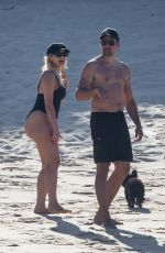 Bebe Rexha Stuns in a black swimsuit as she enjoys a beach day in Cabo