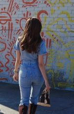 Blanca Blanco Dons a denim jumper for a streetside photoshoot in Los Angeles