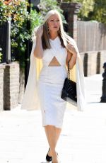 Caprice Bourret In a sexy as she flashes her midriff while heading out for a work meeting in London