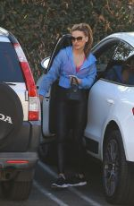 Chrishell Stause Stops by an office building in Los Angeles