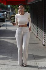 Draya Michele Sports an all white ensemble as she films her reality show today in West Hollywood