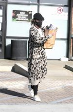 Ellen Pompeo Stays warm in an animal print cardigan as she goes shopping at the Trancas Country Market