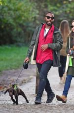 Emilia Clarke Pictured out for a doggy date with a mystery man in North London