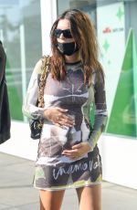 Emily Ratajkowski Cradles her baby bump as she and husband Sebastian Bear-McClard shop at the container store in Los Angeles