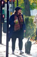 Emma Corrin Out with her dog in London