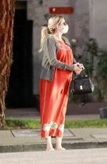 Emma Roberts Dons a maxi orange dress as she visits a friend in Los Feliz
