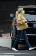 Emma Roberts Is pictured looking casual as she gets help from a male friend to move clothes and pillows in Los Angeles