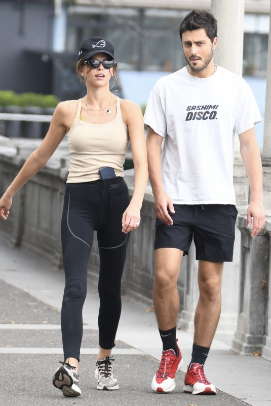 Georgia Fowler and boyfriend Nathan Dalah go for a stroll together after fleeing Adelaide
