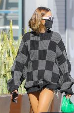 Hailey Bieber In Sweater and cutoffs out in West Hollywood