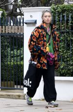 Iris Law Shows off her quirky fashion style while spotted out and about in North London
