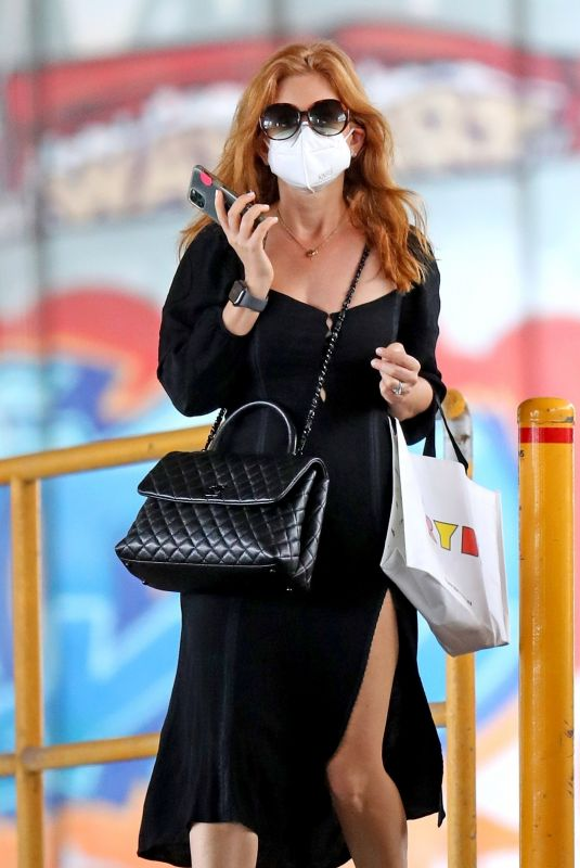 Isla Fisher Spotted running errands in a slitted black dress in Sydney