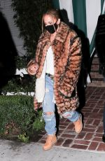 Jennifer Lopez Dons an animal print Coach coat with Timberland boots and denim for dinner at San Vicente Bungalows in Hollywood