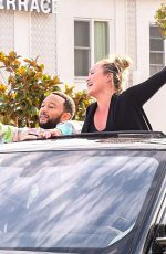 John Legend and Chrissy Teigen celebrate the election results as they dance while riding around in West Hollywood with friends