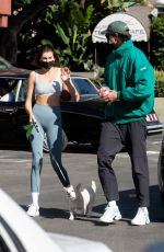 Kaia Gerber & Jacob Elordi both have a smoothie run with their puppy after workout