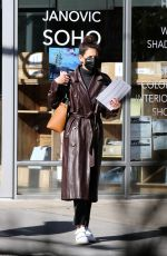 Katie Holmes Sports a stylish brown leather trench coat as she is seen with her hands full in NYC