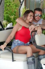 Katie Price and boyfriend Carl Woods share a passionate kiss while on holiday in the Maldives