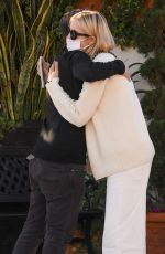 Kelly Rutherford Gives her friend a long hug after meeting for lunch at Porta Via restaurant in Beverly Hills