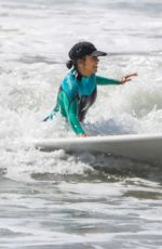 Kourtney Kardashian Getting a surfing lesson in Malibu