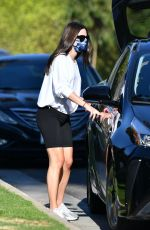 Lea Michele and husband Zandy Reich chat with friends after a walk with the baby