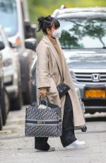 """Lily Allen Spotted carrying a Dior bag with """"MRS H"""" on it and a silver suitcase as leaving New York City"""