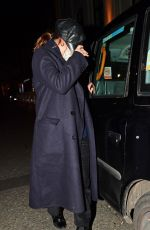 Lily James Hides from the cameras while enjoying a night out with Dominic Cooper in London