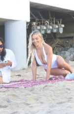 Lindsey Pelas In white at the beach with a friend in Malibu