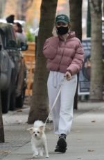 Madelaine Petsch Takes a phone call while walking her dog in Vancouver