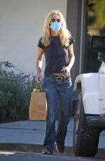 Meg Ryan Picks up food to go in Brentwood